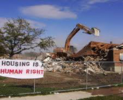 Building demolition w/housing protest sign in New Orleans, Louisiana