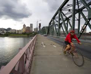 Bicyclist on bridge in Portland, Oregon